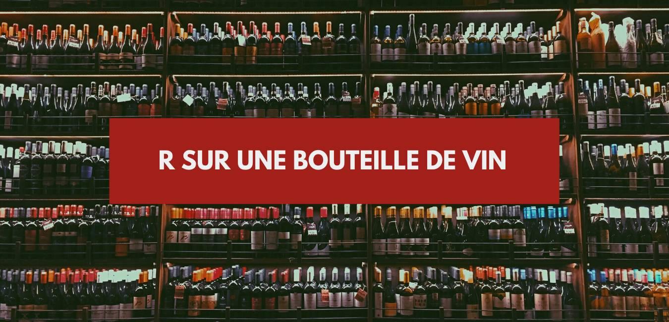 R sur bouteille de vin